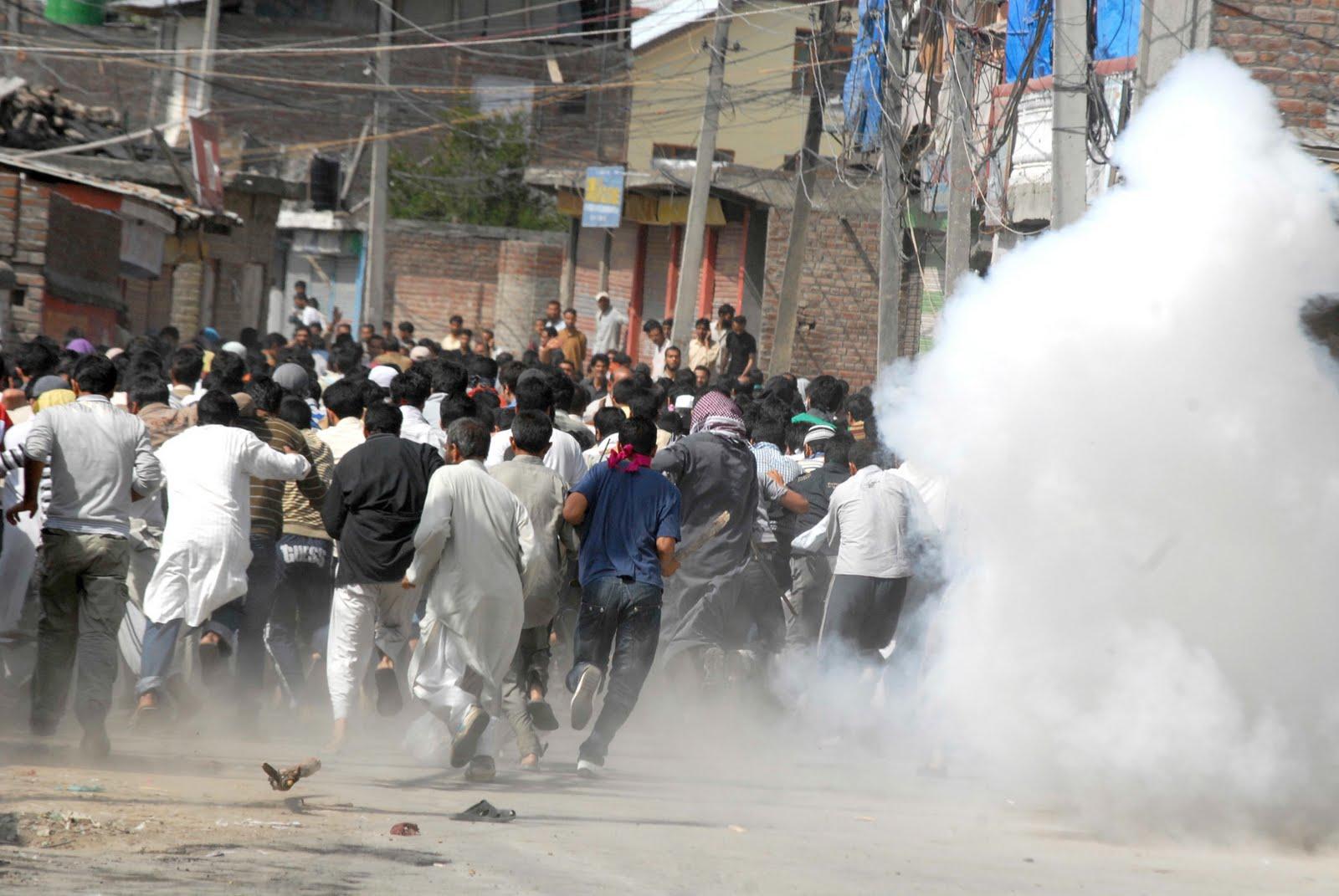 Kashmiri demonstrators being teargassed