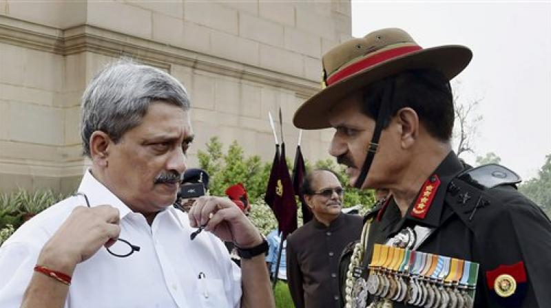 Indian Defense Minister Manohar Parrikar in conversation with Indian Army chief, Gen.Dalbir Singh Suhag