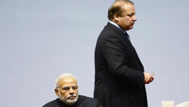 Pakistan Prime Minister Nawaz Sharif walking past Indian Prime minister Narendra Modi