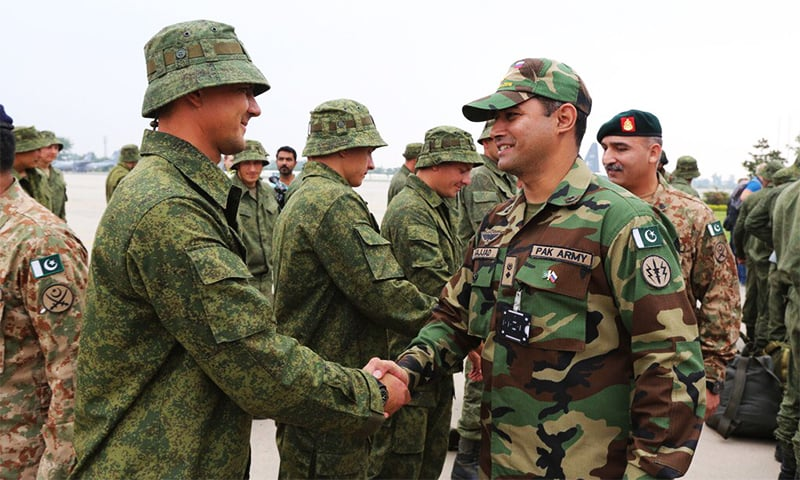 Russian and Pakistani military personnel greet each other at the star of the first ever joint exercises.
