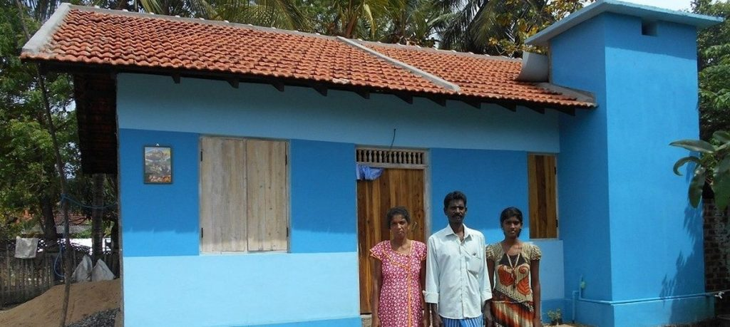 This displaced family is the proud owner of a house they built with Indian aid.